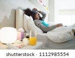 sick african american girl with ... | Shutterstock . vector #1112985554