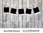 hanging empty polaroid photo... | Shutterstock . vector #1112994029