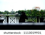 silhouette of a father holding...   Shutterstock . vector #1113019931