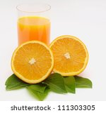 orange on a white background with a glass of juice - stock photo