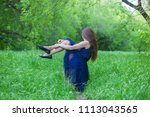 Small photo of go off concept. the girl leaves. distance. end of love. attractive girl in nature. with long dark hair