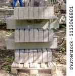 Small photo of Concrete curb stone in the heap