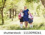 happy woman hugs kids in school ...   Shutterstock . vector #1113098261