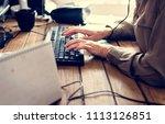 caucasian woman using computer | Shutterstock . vector #1113126851
