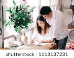 asian couple sitting in a... | Shutterstock . vector #1113137231