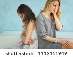 mother and daughter are sitting ...   Shutterstock . vector #1113151949
