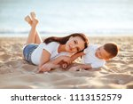 mother and son sitting on the...   Shutterstock . vector #1113152579