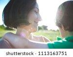 mother hugs the boy. a woman is ...   Shutterstock . vector #1113163751
