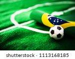 brazil flag and soccer ball on... | Shutterstock . vector #1113168185