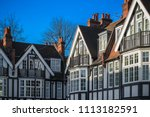 exterior of tudor revival style ... | Shutterstock . vector #1113182591