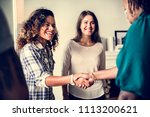 diverse woman shaking hands | Shutterstock . vector #1113200621