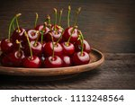 a clay dish filled with ripe... | Shutterstock . vector #1113248564