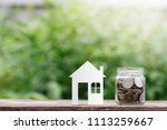 coins in glass jar with house... | Shutterstock . vector #1113259667