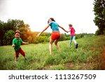 children walk with their mother ...   Shutterstock . vector #1113267509