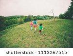 a woman with children runs...   Shutterstock . vector #1113267515