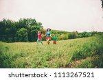 a woman with children runs...   Shutterstock . vector #1113267521