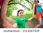 a woman with child goes on a...   Shutterstock . vector #1113267539