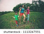 a woman with children goes...   Shutterstock . vector #1113267551