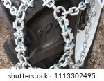 large tire with snow chains    Shutterstock . vector #1113302495