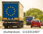 a lorry traveling along a... | Shutterstock . vector #1113312407