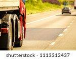 a closeup of wheels in motion... | Shutterstock . vector #1113312437