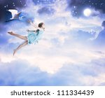 Little girl flying into the blue night sky with white egret - stock photo