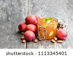 red apricot  jam with almonds... | Shutterstock . vector #1113345401
