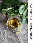 linden blossoms tea in a glass... | Shutterstock . vector #1113367499