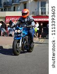 Small photo of Hastings,East Sussex/UK 07/05/18 Bike 1066 the annual May Day bike run to Hastings. A blue Suzuki Bandit motorbike arrives on Hastings seafront to join thousands of other motorcycles
