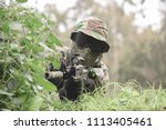 airsoft soldier in the woods | Shutterstock . vector #1113405461