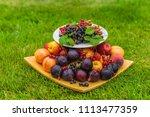 a platter of fresh fruits and... | Shutterstock . vector #1113477359