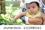 young mother holding her baby...   Shutterstock . vector #1113480161
