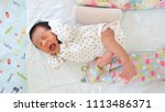 cute newborn baby boy lying on...   Shutterstock . vector #1113486371