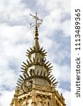 Small photo of Spire, cross and wind vane at the top of Toledo's Santa María cathedral tower.