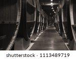 vintage wooden barrels in... | Shutterstock . vector #1113489719