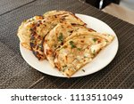 indian naan bread made with... | Shutterstock . vector #1113511049