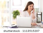 young woman talking on phone at ... | Shutterstock . vector #1113515207