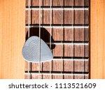 grey guitar pick on wooden... | Shutterstock . vector #1113521609