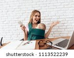 smiling business woman working...   Shutterstock . vector #1113522239