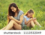 happy mother and smiling kid...   Shutterstock . vector #1113532049