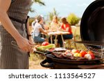 man cooking meat and vegetables ... | Shutterstock . vector #1113564527