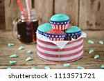 cupcakes red and blue velvet on ... | Shutterstock . vector #1113571721