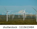 wind farm with mountain in... | Shutterstock . vector #1113613484