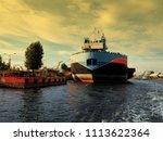 dockyard with heavy freight... | Shutterstock . vector #1113622364