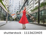 beautiful woman in red dress... | Shutterstock . vector #1113623405