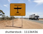 Emergency airstrip sign with road train in the Nullarbor desert in Australia - stock photo