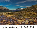 A Scenicv View Of A River With...