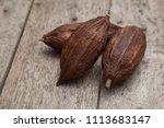 cocoa pod on a dark rustic... | Shutterstock . vector #1113683147