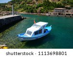 small fishing boats anchored in ... | Shutterstock . vector #1113698801