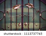 wrought iron gates  ornamental... | Shutterstock . vector #1113737765